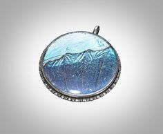 morpho butterfly wing 800 silver pendant in very fine condition. signed with un identified mark. color varies with angle of view. Morpho Butterfly, Butterfly Wings, Silver Rings, Pendants, Etsy, Jewelry, Jewellery Making, Pendant, Jewelery