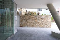 Modern architecture meets traditional stone. Visit our website for more ideas on how to improve your home