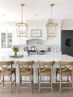 To improve the interior of your home, you may want to consider doing a kitchen remodeling project. This is the room in your home where the family tends to spend the most time together. If you have not upgraded your kitchen since you purchased the home,. Home Decor Kitchen, New Kitchen, Kitchen Dining, Kitchen Cabinets, White Kitchen Decor, Kitchen Island With Chairs, White Kitchen With Marble, White Kitchen Designs, White Kitchen Stools