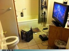 Homeowner has turned this bathroom into a media room. It has everything a man cave needs, and it's all accessible from the toilet.