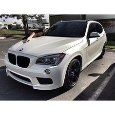 BMW X1 Wrapped in Satin Pearl White Vinyl.