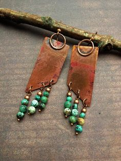 Handmade copper earrings with African turquoise. I hand crafted these earrings by cutting copper, soldering on oversized loops, then adding beautiful green/blue turquoise dangles. Very stunning, rich