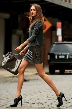 Love the Michael Kors bootie shoe with the short skirt. Looks like she's walking in TriBeCa. I wonder?