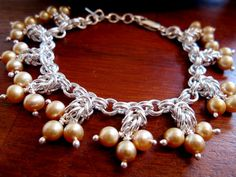Cloudberry, Sterling silver chainmaille bracelet with fresh water pearls.