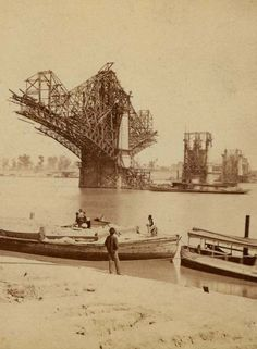 The Eads Bridge under construction in 1873.  Its completion would speed up the demise of the steamboat era, as now the nation was connected by land over the great divide of the Mississippi River.  Missouri History Museum