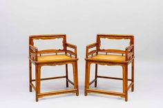 A pair of Huanghuali Wood Rose Chairs, Qing Dynasty, late 17th Century