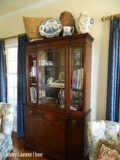 Baskets Blue Dishes And Books In Cabinet Everything Really China Cabinets Hutches