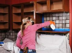 Painting Kitchen Cabinets. Step-by-step instructions (including videos) on how to repaint your kitchen cabinets, whether they be wood, wood-laminate or metal.