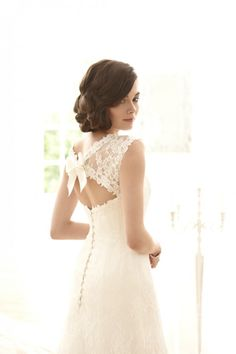 love the bow on the back of this lace gown