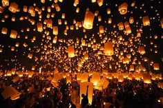Lanterns float as part of a Buddhist celebration in Maejo, Thailand.