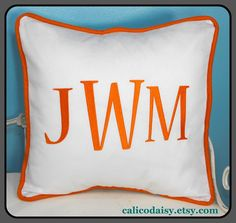 Monogrammed pillow in navy and white, 16x16.  $37.99 via Etsy.