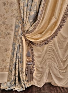 [The wallpaper makes an excellent background for these curtains.]