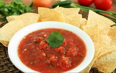 5 Roma tomatos 1 can petite diced tomatoes with green chilis, undrained 2 green onions 3 Tbsp yellow onion or red onion 2 serrano peppers, stems removed  1/3 cup fresh cilantro  1 clove garlic Juice of 1 lime 1/2 tsp chili powder 1/4 tsp ground cumin Salt and pepper to taste   Combine all ingredients in a food processor and chop until all ingredients are finely chopped.