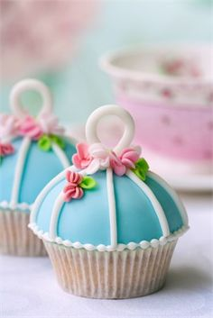 pastel blue vintage style birdcage wedding cupcake with pink flowers @Carley Fessel check these bad boys out! haha