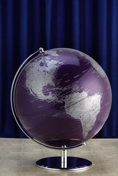 The traditional, functional world globe makes a new entrance with a dramatic flair with our World Globe in aubergine.
