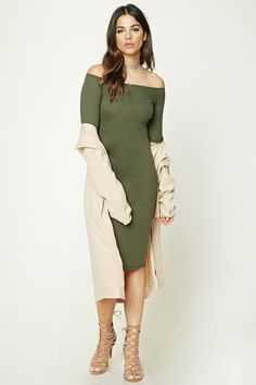 A ribbed knit midi dress featuring an off-the-shoulder neckline, short sleeves, and a bodycon silhouette.