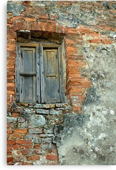 A crumbling wall in Tuscany. with a decaying wooden window. • Also buy this artwork on wall prints, home decor, stationery, and more.