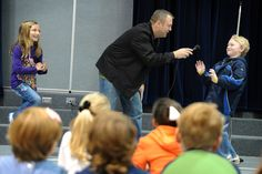 Jerry Ackerman of McCordsville, Ind., prompts third grader Brody Harlow, 8, to act aggressive Jan. 9, during an anti-bullying presentation at Woodmen Hills Elementary School in Falcon School District 49. To equip kindergarten-fifth grade students to combat bullying in their schools and communities, Ackerman presented a mix of comedy, respect and roll playing exercises at Woodmen Hills Elementary School and Falcon Elementary School in Peyton, Colo.