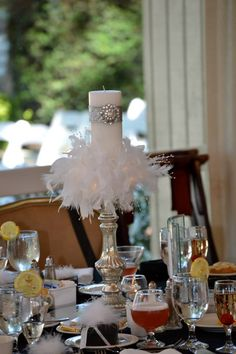 Centerpiece. Feather boa (cut to width of candle) with led lights .