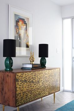 loving the vignette created over this console as an entryway details for a modern home