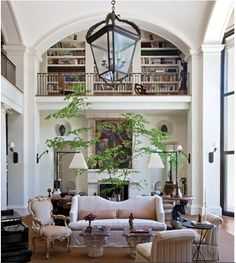 chandilier, high ceilings, bookcases, stylelins