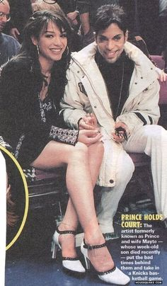 Mayte Garcia and Prince, court side: