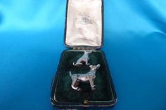 Fabulous pair of Arts and Crafts silver cast dog menu holders London 1910