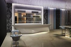 The polished marble floor and biomorphic, asymmetrical bar create a space age feel, this is the reception desk of a new hotel in Italy.