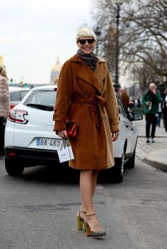 Très Chic! The Best Street Style at Paris Fashion Week : Elisa Nalin pulled together a bundled-up look with a corduroy trench, then finished with metallic heels.