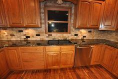 Black kitchen granite countertops with tile backsplash
