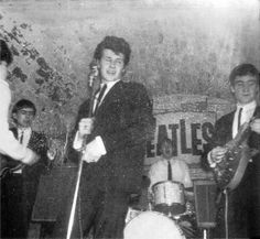The Beatles in the Cavern Club with Pete Best singing ad Paul McCartney on the drums