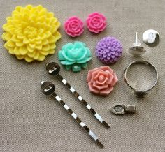 Each deal includes 12 items – $2.97    As the weather gets warmer, you'll want to start celebrating the season with some pops of COLOR!    We've put together a great accessory kit that allows you to mix and match 6 flower cabochons to create 2 bobby pins, one charm, one ring and one pair of earrings.  With a little imagination and just a few dabs of your favorite jewelry glue, you can make some gorgeous & colorful accessories.  Keep for yourself or give as a gift.