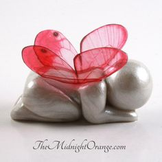 This sleeping clay baby butterfly figurine is a tender gift for miscarriage and child loss, and a special way to remember a baby who touched the stars too soon, whether buying personally or for someone you care about that you just dont have the words for but want to express your sympathy. This listing is for *one* butterfly baby. I make every one of my sculptures by hand, and with your choice of wing color which youll choose from the drop down menu.  Size: Approximately 2 inches, please see…