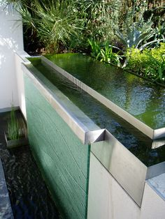 Multi-tiered stainless steel and glass water feature. Pinned to Garden Design - Water Features by Darin Bradbury.