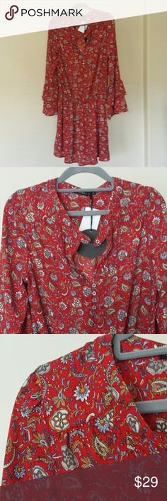 Harlow and Graham dress Ruffled long sleeves, small floral-paisley  design. Buttons at the neck. Harlow Dresses