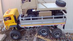 RC Axial scx10 truck carrying ECX Barrage in crawler course