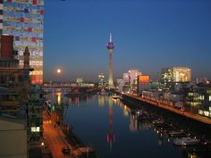 Mediemhafen Dusseldorf night - Rheinturm and Gehry Buildings. Germany