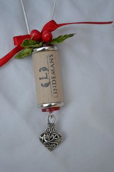 Wine cork ornament with silver heart. $6.00, via Etsy.