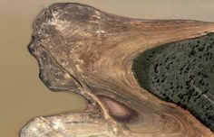 An aerial view of the Atibainha dam, part of the Cantareira reservoir, during a drought in Braganca Paulista, Sao Paulo state. The state's authorities have said that the reservoirs serving metropolitan Sao Paulo, South America's largest city, could dry out by February if relief does not arrive in the upcoming rainy season. Picture: REUTERS/Nacho Doce