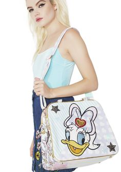 Irregular Choice So Pretty Bag and that's exactly what yew are, bb! This adorable bag features yer fav pretty girl on da front, top handles, a removable adjustable shoulder strap, and a roomy interior fer everything yew need.