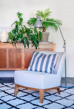 blue boho vibes | rustic credenza with abundance of plants | IKEA Stockholm Easy chair with a Bemz cover in Sandhamn Stripe | blue and white striped cushion