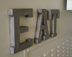 DIY faux metal letters using grey painted base + Rub 'N Buff in pewter