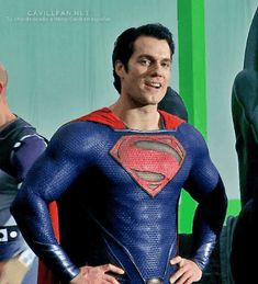 Mr Cavill filling every micron of that suit - very well indeed!