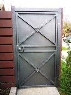 """Wrought iron patio / garden gate for my 4plex on W Gray (in Montrose).  Painted a Rustoleum color called """"hammered silver"""".  (Medusa Properties)"""