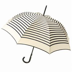 Guy de Jean / striped long umbrella by Jean Paul Gaultier. a lovely way to combat those rainy days.