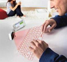 Keychain Laser Projection Virtual Keyboard. Yep