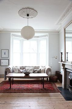 living room: chesterfield sofa and ethnic rug