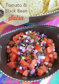 Enjoy the taste of summer with the delicious produce available now in this Tomato and Black Bean Salsa recipe | The Happy Housewife