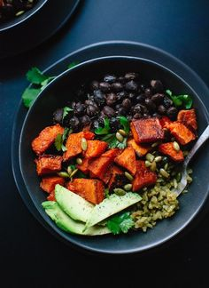 Healthy burrito bowls made with roasted sweet potato, green rice and black beans! This delicious, vegan dinner reheats well for lunch.