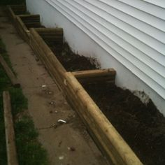 Tiered raised bed garden boxes.   Idea for along the side of the house